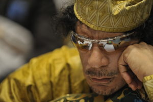 Muammar Gaddafi, Leader of the Revolution of the Great Socialist PeopleÕs Libyan Arab Jamahiriya, sits reading in the Plenary Hall of the United Nations (UN) building in Addis Ababa, Ethiopia, during the 12th African Union (AU) Summit