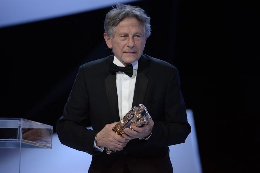 Honteux, le cinéaste franco-polonais Roman Polanski reçoit le César du Meilleur réalisateur pour La Vénus et la fourrure en 2014 Crédit MARTIN BUREAU - AFP
